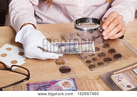 Woman Looks At The Turkish Lira Through A Magnifying Glass
