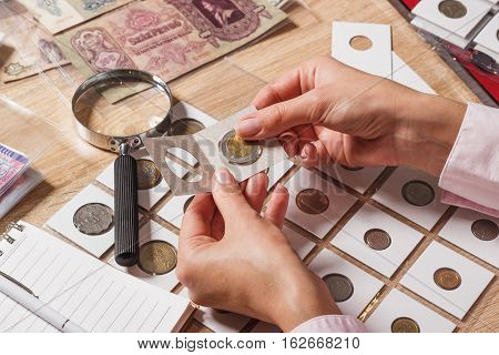 Woman Looks At The Collector S Coin