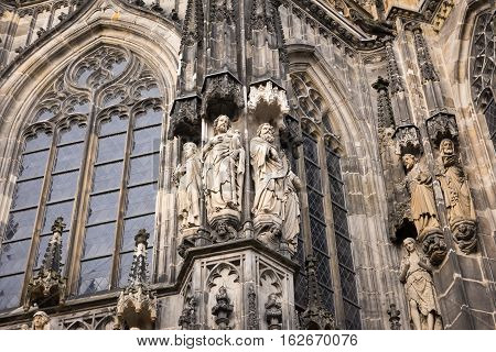 Stone figures from the facade of Aachen Cathedral, Germany