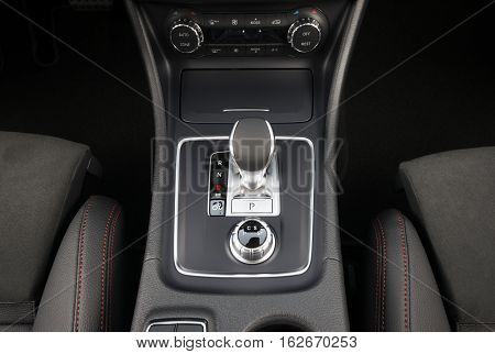 Modern sport car interior, black leather, gear shift stick