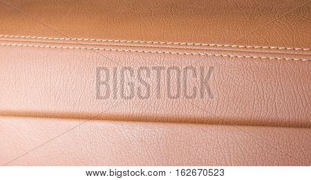 Part of orange, sand leather, seam focused