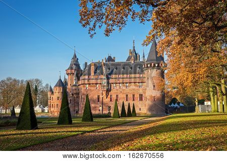 View of the medieval castle  De Haar fron the park in the fall, The Netherlands