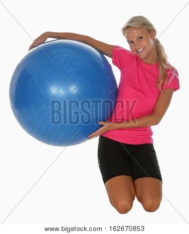 Lovely blonde girl with a big blue exercise ball