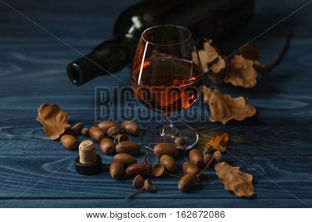 Scotch On Wooden Background With Copyspace. An Old And Vintage Countertop With Highlight And A Glass