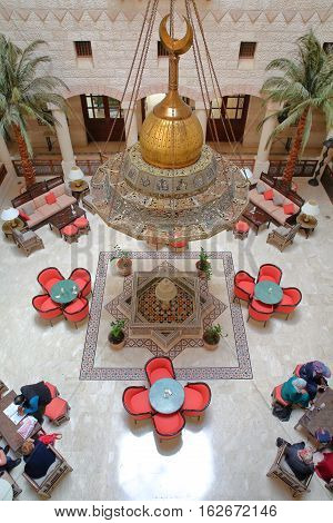 PETRA, JORDAN - MARCH 10, 2016: The magnificent courtyard atrium of the Movenpick Hotel located at the entrance of the site