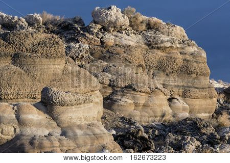 Tufa formations along a lake bed in the desert