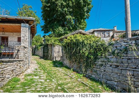 Stone walkway and houses in Monodendri one of the stone villages of Zagoria. Epirus Greece