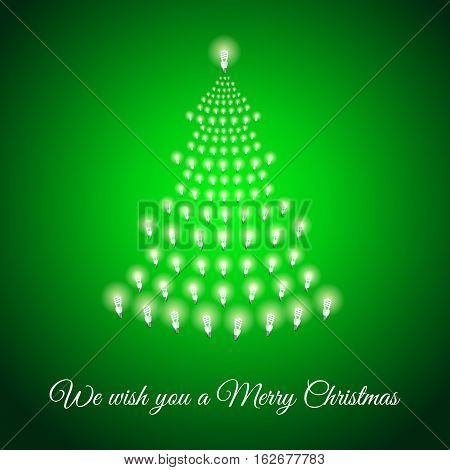 Shining Xmas tree made of bulbs on green luminous background.Luminous bulbs in shape of xmas firtree.Merry Christmas wish postcard, saving energy concept.