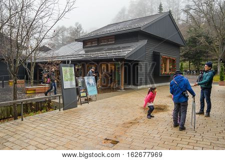 Karuizawa,Japan - 20 November 2016 : Many people walking in the Harunire Terrace, This is a trendy, upmarket shopping and dining area built on a wooden terrace and surrounded by the forest.