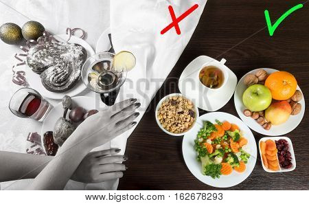 Table with healthy and unhealthy food and alcohol. Woman hands covering the part with harmful dishes and drinks with table cloth. Dieting after Christmas and New Year celebration.