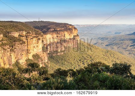 At Wentworth Falls, Sydney, New South Wales, Australia. This wilderness area forms part of the Blue Mountains National Park. Image features the escarpment and Grose Valley in afternoon sun.
