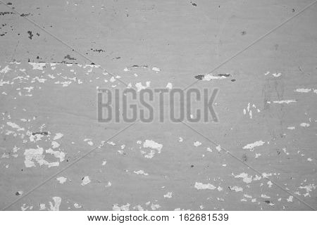 Black and white distressed wooden painted texture. Monochrome texture with obsolete paint. Painted distressed shabby chic backdrop. Cracked paint close-up image. Weathered wooden texture background