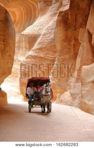 PETRA, JORDAN - MARCH 13, 2016: The Siq Canyon leading to The Treasury (Al Khazneh)