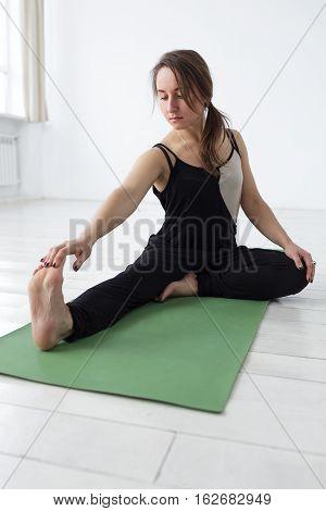 Beautiful Girl Sitting In  Yoga Asana, Prepare For Janu Sirsasana