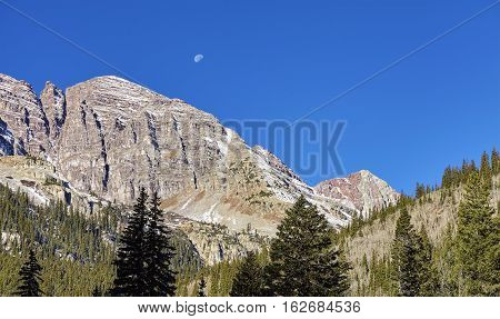 Maroon Bells Mountain Range With Moon Above, Usa.
