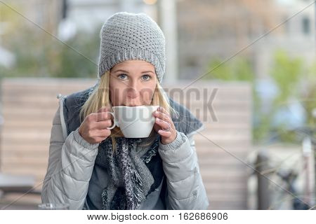 Woman Enjoying A Hot Cup Of Coffee In Winter