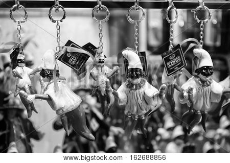 Naples Italy - December 9 2016: San Gregorio Armeno pendants handmade depicting the mask of Pulcinella and the horn of red coral superstitious symbol for the Neapolitans.