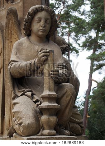 Stone Exterior Statue of a Kneeling Angel