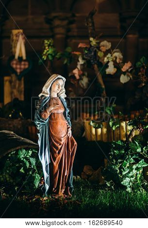 Strasbourg, France - Dec 20, 2016: Nativity scene statues during Christmas Market in Strasbourg France with pregnant Mary