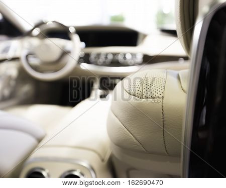 Modern business car interior  with white perforated leather