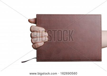 Hand holding brown diary with leather hardcover isolated on white background