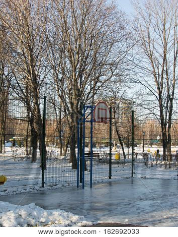 basketball hoop on the frozen ground, winter