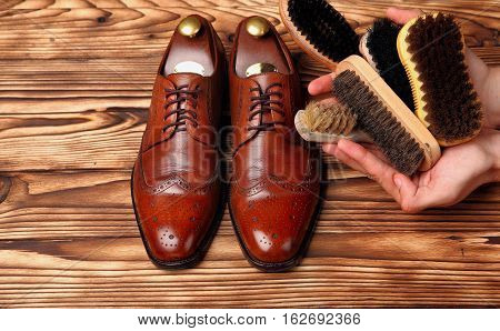 Brogues And Different Brushes For Shoes In Hands
