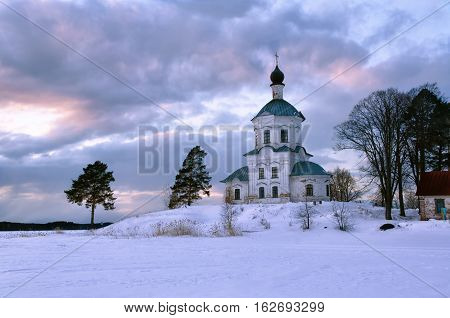 The church stands on the shore of a frozen lake on a frosty winter vecher.Rossiya. Lake Seliger..