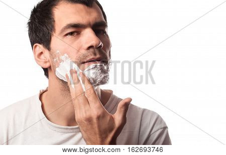 Time for new razor. Close-up young shirtless man holding razor
