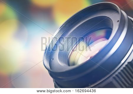 Camera lens with lens reflections and bokeh background