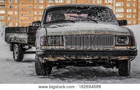 Old car, old farm vehicle with a trailer, gray rusty car, grunge car