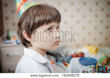 sad little boy on his birthday at home