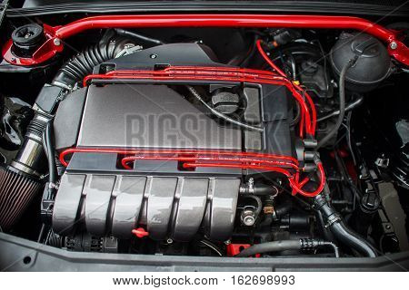 close up on red sports car engine