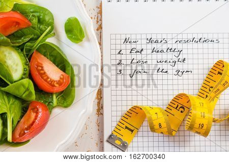 Making list of New Year's resolutions with healthy lifestyle