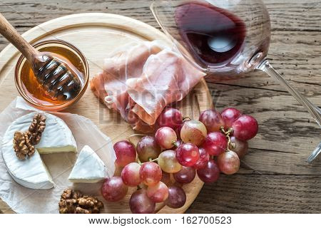 Camembert Cheese With Glass Of Red Wine