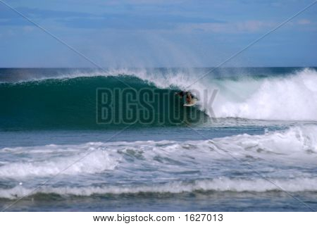 Surfer In A Tube Wave