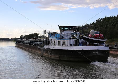 HILPOLTSTEIN GERMANY - OCT 02 2016 : Inland freight water vessel Konrad Brand passes the lock Eckersmuehlen on the Rhine-Main-Danube Canal in Bavaria.