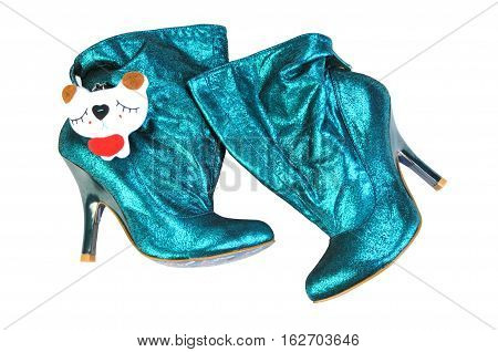 Women's boots of shiny skin turquoise. Ankle boots shoe fashionable products isolated on white