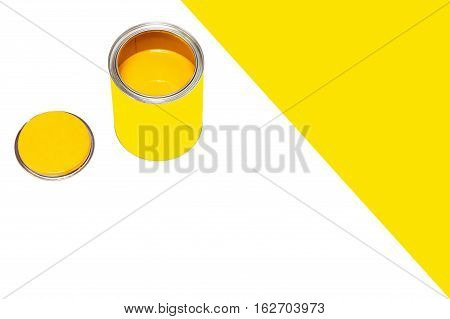 Bank of yellow paint on white background with empty space for text.