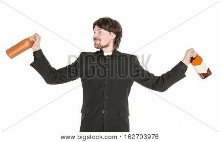 Young Cheerful Priest With Bottle Of Alcohol Isolated