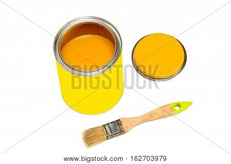 Bank of orange paint and paintbrush isolated on white background.