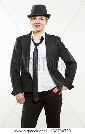 Beautiful young woman posing in business suit. Isolated over white background.