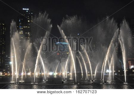 DUBAI, UAE - DEC 10: The Dubai Fountain in Dubai, UAE, as seen on Dec 10, 2016. It is the world's largest choreographed fountain system set on the 30-acre manmade Burj Khalifa Lake, at the center of the Downtown Dubai.