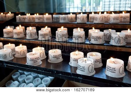 Berlin Germany - july 1 2016: Burning candles at the Interior of the Kaiser Wilhelm Memorial Church