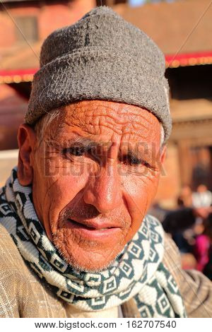 PATAN, NEPAL - DECEMBER 21, 2014: Portrait of an old Nepalese man at Durbar Square