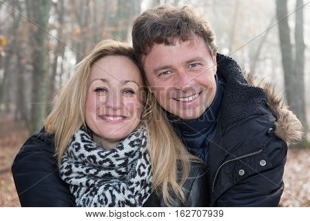 Forties Blond Woman And Husband In Fresh Park