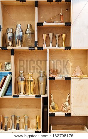 Barman equipment. Bartender tools in wooden boxes