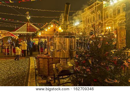 MOSCOW RUSSIA - DECEMBER 19 2016: Large samovar on Red Square. Annual Christmas Fair. Moscow Russia December 2016.