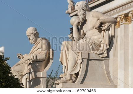 classic statues of Plato and Socrates, sky