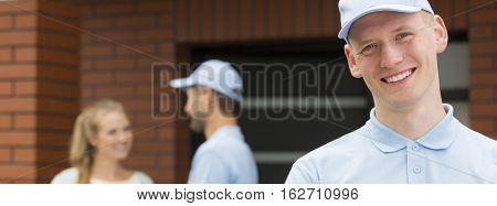 Handsome Courier Wearing A Blue Shirt And A Cap